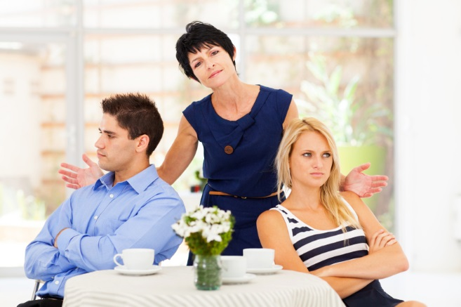 middle aged mother feeling helpless when caught in between young couple's fight
