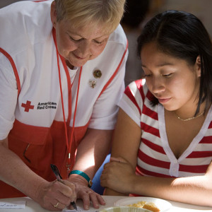 800px-FEMA_-_29748_-_Red_Cross_volunteer_and_shelteree_in_NJ,_photography_by_Andrea_Booher