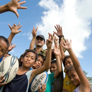 Samoan_kids_are_all_smiles_after_receiving_rugby_balls_from_the_NZ_Army_-_Flickr_-_NZ_Defence_Force